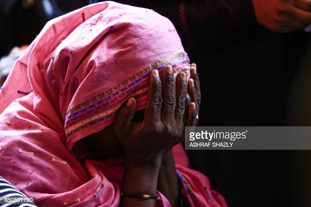 A picture taken on March 9 2017 shows a Sudanese woman reacting after several prisoners were released from the Sudanese Cooper prison north of the...