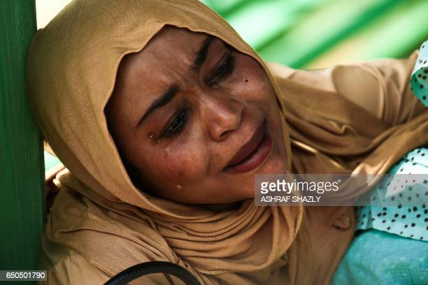TOPSHOT A picture taken on March 9 2017 shows a Sudanese woman reacting after several prisoners were released from the Sudanese Cooper prison north...