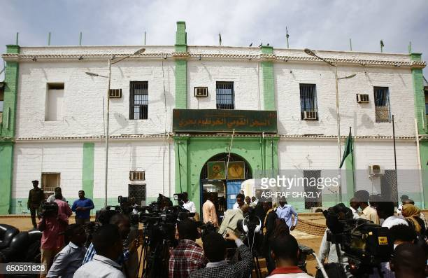 A picture taken on March 9 2017 shows members of the press gathering outside the Sudanese Cooper prison north of the capital Khartoum as prisoners...