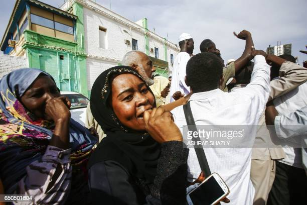 A picture taken on March 9 2017 shows Sudanese people reacting after several prisoners were released from the Sudanese Cooper prison north of the...