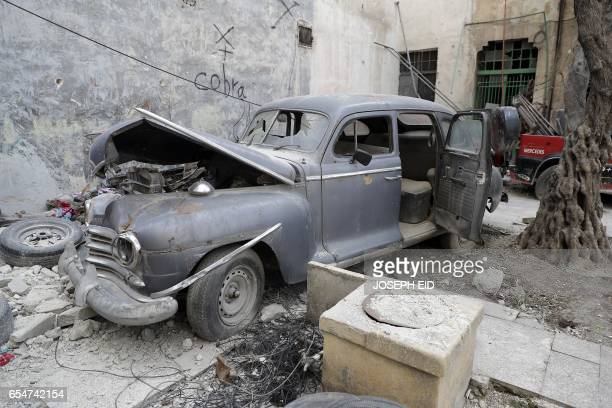 A picture taken on March 9 shows a 1947 Plymouth parked in the garden of Mohammed Mohiedin Anis or Abu Omar's home in Aleppo's formerly rebelheld...
