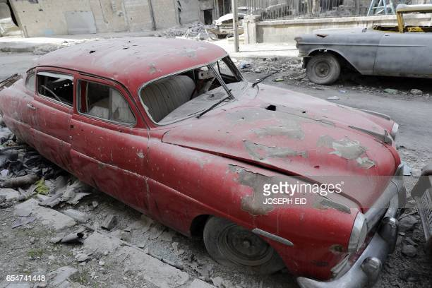 A picture taken on March 9 shows a 1949 Hudson Commodor parked outside the home of Mohammed Mohiedin Anis or Abu Omar in Aleppo's formerly rebelheld...