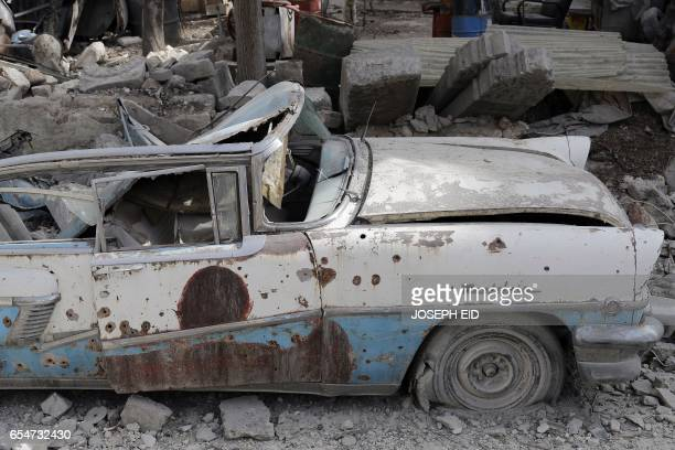 A picture taken on March 9 shows a 1957 Mercury Montclair parked outside the home of Mohammed Mohiedin Anis or Abu Omar in Aleppo's formerly...