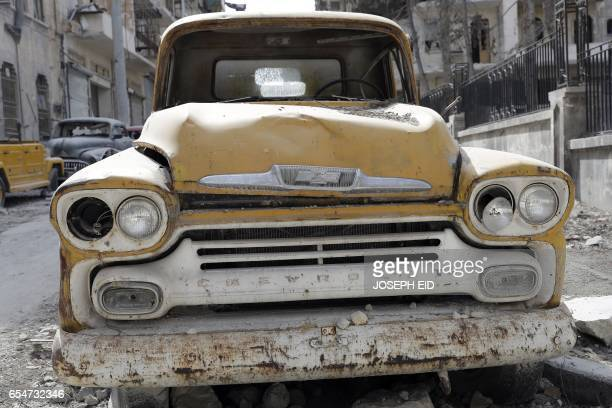 A picture taken on March 9 shows a 1958 Chevrolet Apache truck parked outside the home of Mohammed Mohiedin Anis or Abu Omar in Aleppo's formerly...