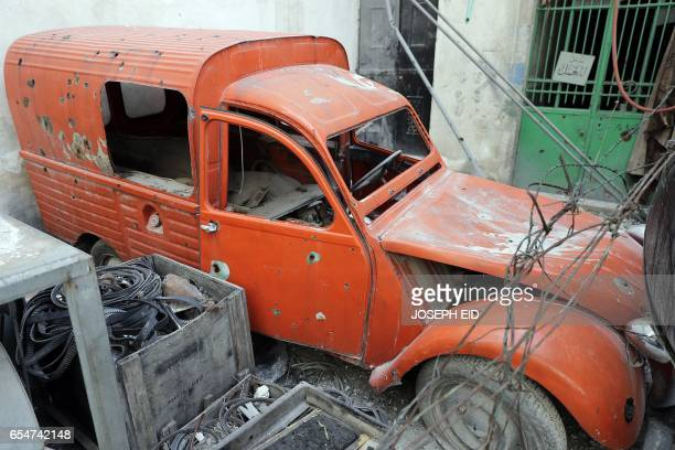 A picture taken on March 9 shows a 1977 Citroen Acadiane parked in the garden of Mohammed Mohiedin Anis or Abu Omar's home in Aleppo's formerly...