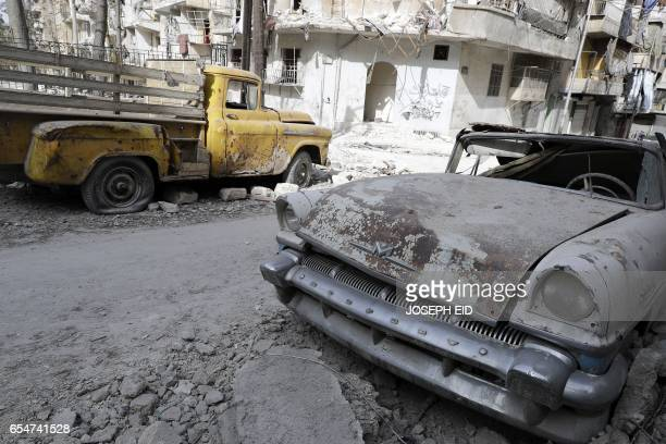 A picture taken on March 9 shows vintage cars parked outside the home of Mohammed Mohiedin Anis or Abu Omar in Aleppo's formerly rebelheld alShaar...
