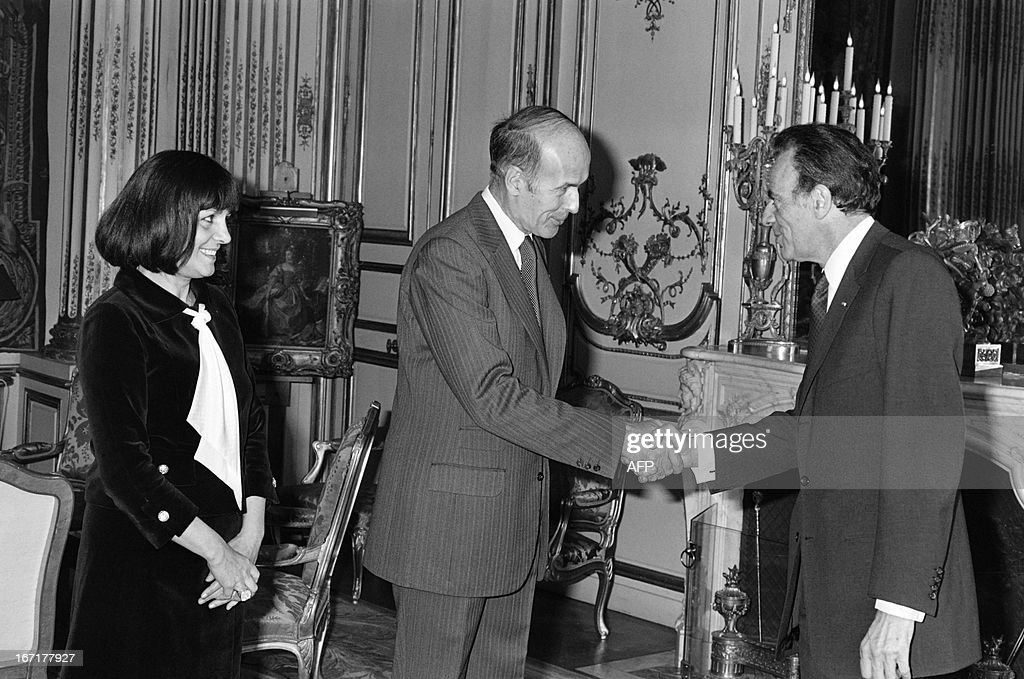 A picture taken on May 10, 1977 at the Elysee palace in Paris shows France's medicine nobel prize laureate Francois Jacob (R) shaking hands with French president Valery Giscard d'Estaing (C) eyed by Junior minister for Universities Alice Saunier-Seite prior to a meeting. French biologist Francois Jacob, who won the 1965 Nobel prize for medicine for his research into enzymes, has died at the age of 92, a relative told AFP on April 21, 2013.