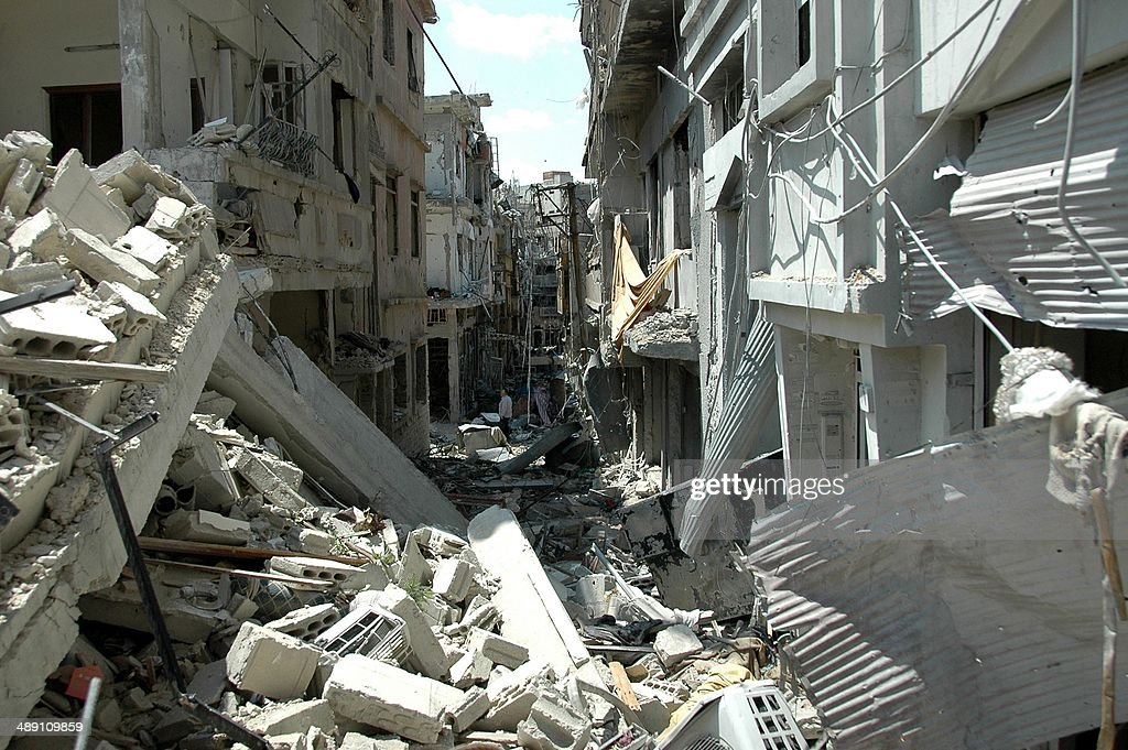 A picture taken on May 10 2014 shows heavily damaged buildings in the Juret alShayah district of the central city of Homs a day after the last Syrian...