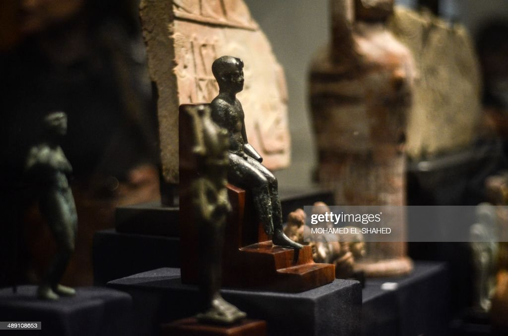 A picture taken on May 10, 2014 shows statuettes displayed at the Egyptian Museum in Cairo. Egyptian Minister of Antiquities Mohamed Ibrahim gave a press conference to announce the recovery of Pharaonic artefacts that were stolen from Egyptian museums' collections in 2011 and 2013 during the political events in the country.
