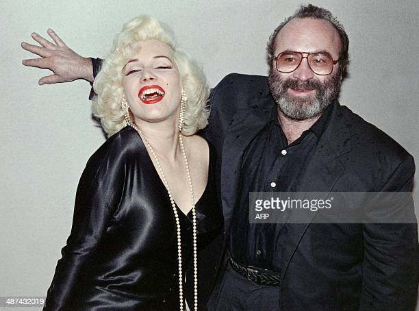 A picture taken on May 12 1988 shows British actor Bob Hoskins posing with Olivia Link impresonator of Marilyn Monroe at the opening of the 1988...
