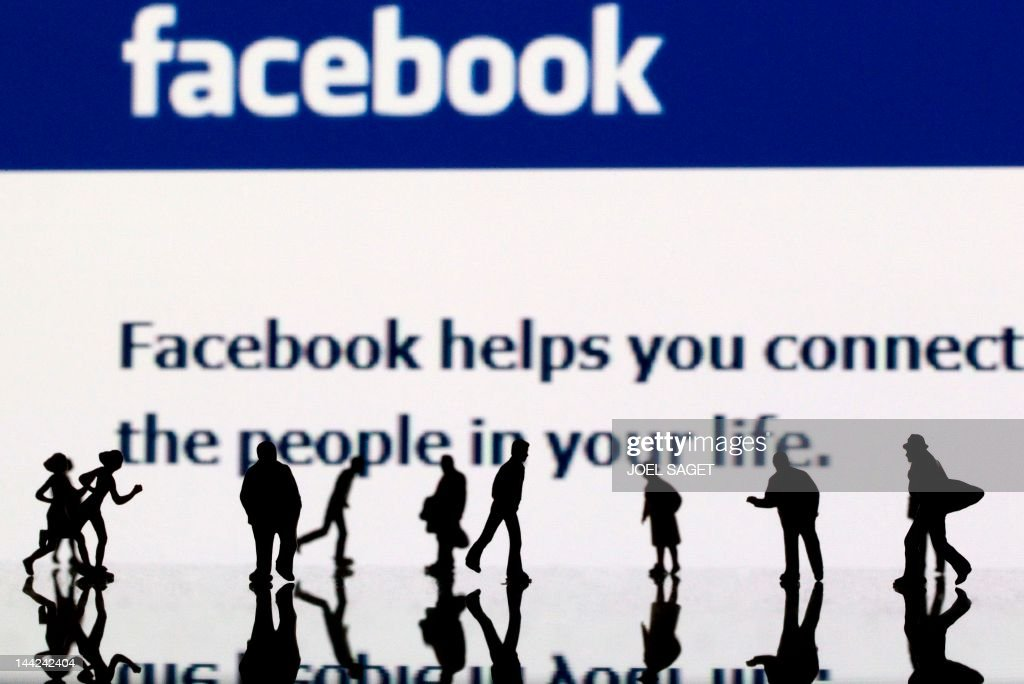 Picture taken on May 12, 2012 in Paris shows an illustration made with figurines set up in front of Facebook's homepage. Facebook, already assured of becoming one of the most valuable US firms when it goes public later this month, now must convince investors in the next two weeks that it is worth all the hype. Top executives at the world's leading social network have kicked off their all-important road show on Wall Street -- an intense marketing drive ahead of the company's expected trading launch on the tech-heavy Nasdaq on May 18.