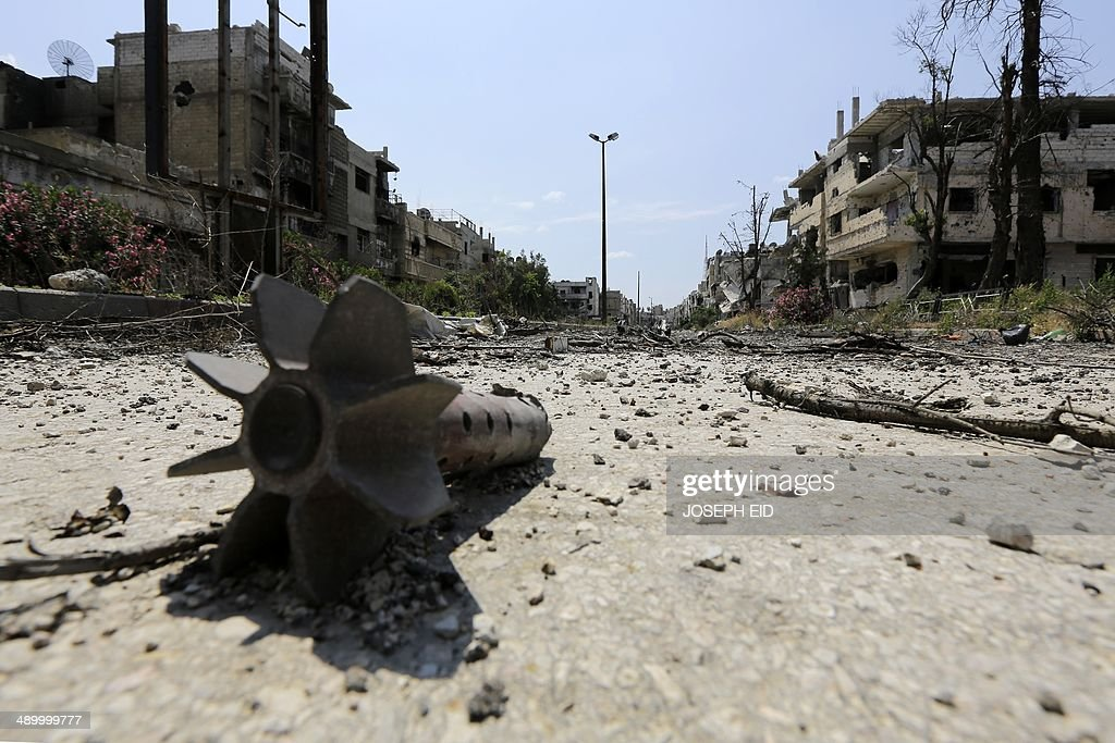 A picture taken on May 12 2014 shows a remaining mortar round in a destroyed neighbourhood of the Old City of Homs some 162 kilometres north of the...