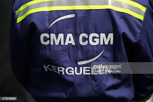 A picture taken on May 12 2015 shows on the overall of a mechanic the logo and the name of the container ship 'Kerguelen' ordered by French container...