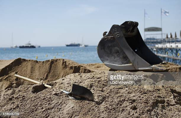 A picture taken on May 12 shows a shovel left by a worker digging a beach on the Croisette on the eve of the 68th Cannes Film Fes tival in Cannes...