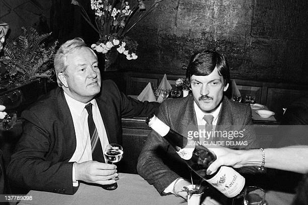 A picture taken on May 13 1984 shows French founder and president of farrighter National Front JeanMarie Le Pen having a glass a wine from Alsace in...