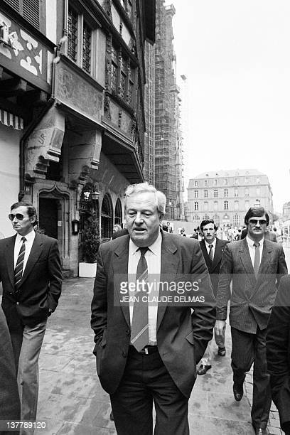 A picture taken on May 13 1984 shows French founder and president of farrighter National Front JeanMarie Le Pen taking a stroll in the streets of...