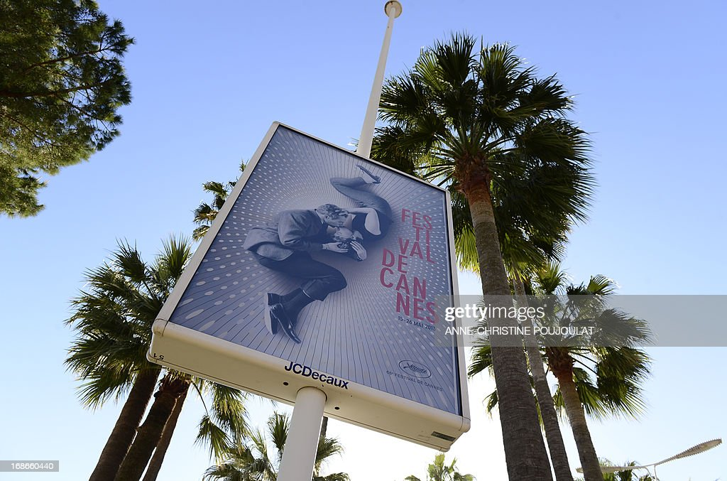 A picture taken on May 13, 2013 in Cannes shows the official poster of the 66th Cannes Film Festival, featuring a 50-year-old photo of Hollywood love match Paul Newman and Joanne Woodward locked in a tender embrace, two days before its opening. Cannes, one of the world's top film festivals, opens on May 15 and will climax on May 26 with awards selected by a jury headed this year by Hollywood legend Steven Spielberg.