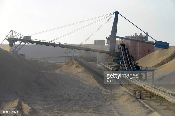 A picture taken on May 13 2013 shows untreated phosphate being dropped off on a montain at the end of a conveyor belt at the Marca factory of the...