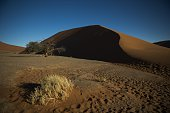 A picture taken on May 13 2015 the Namibia Naukluft National Park near Sesriem shows red dunes of the salt desert of Sosusvlei AFP PHOTO / MARTIN...