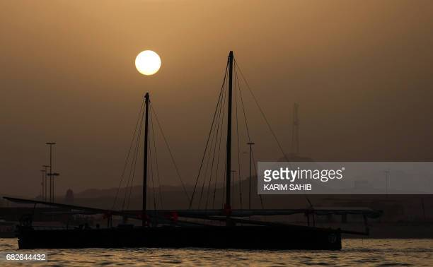 A picture taken on May 13 2017 near the island of Sir Bu Nair shows a dhow participating in a training session on the eve of alGaffal traditional...