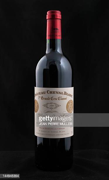 A picture taken on May 14 2012 in Bordeaux southwestern France shows a bottle of French SaintEmilion 'Grand Cru classe' wine Chateau Cheval Blanc AFP...