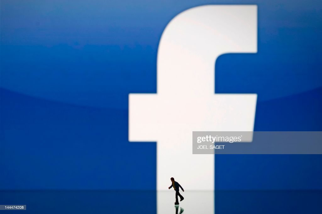 A picture taken on May 14, 2012 in Paris, shows an illustration made with a figurine set up in front of Facebook's homepage. Facebook, already assured of becoming one of the most valuable US firms when it goes public later this month, now must convince investors in the next two weeks that it is worth all the hype. Top executives at the world's leading social network have kicked off their all-important road show on Wall Street -- an intense marketing drive ahead of the company's expected trading launch on the tech-heavy Nasdaq on May 18.