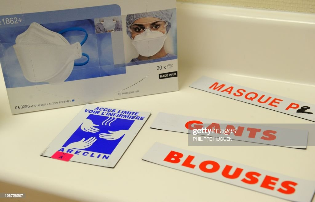 A picture taken on May 14, 2013 shows a box of medical masks and signs reading (from top) 'masks', 'gloves' and 'blouse'' at the infectious diseases unit at the Tourcoing Hospital, northern France. The World Health Organisation called on people earlier this week in France, where two confirmed cases of the new SARS-like virus were recorded at the weekend, to stay calm and not overburden hospitals for fear of the deadly virus to allow for proper treatment of those actually infected.The coronavirus, known as nCoV-EMC, is a cousin of the virus that causes Severe Acute Respiratory Syndrome (SARS), which killed nearly 800 people in the Far East in 2002-03. In all, 34 cases have been reported worldwide since the virus was first detected in September 2012, with 18 of the victims dying, mostly in Saudi Arabia. AFP PHOTO PHILIPPE HUGUEN