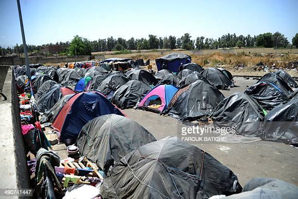 A picture taken on May 14 2014 shows tents of Illegal migrants from Niger settled some of them for more than one year near the fruit market in the...