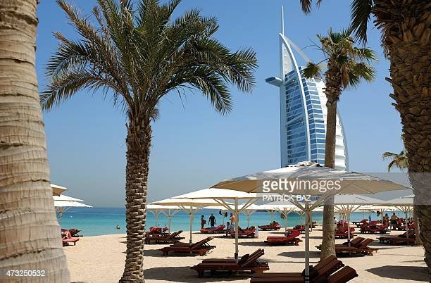 A picture taken on May 14 2015 shows a view of Dubai's Burj alArab hotel seen from the Mina alSalam beach hotel and touristic resort in Jumeirah AFP...