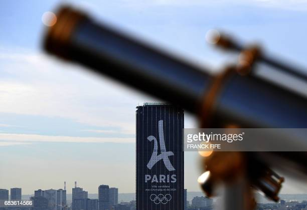 A picture taken on May 16 2017 show the Montparnasse tower during the Paris 2024 Promotion campaign as the IOC Evaluation Commission visits Paris...