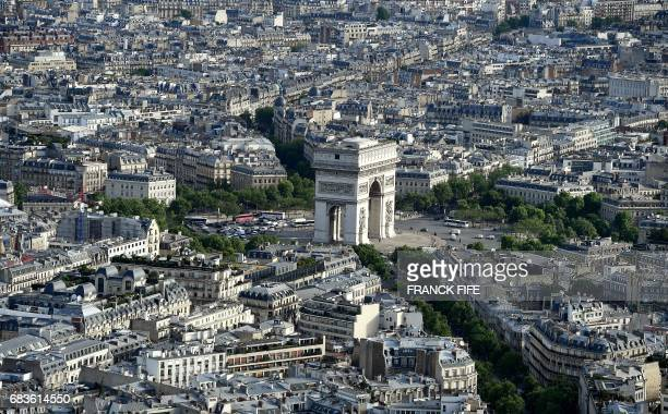 A picture taken on May 16 2017 shows the Arc De Triomphe as the IOC Evaluation Commission visits Paris before a vote for the 2024 Summer Olympics The...