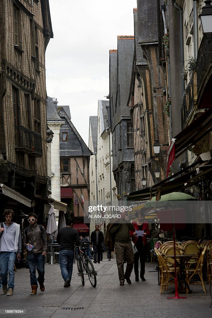 A picture taken on May 17, 2013 shows people walking in a street of Tours' center. Tours is one of the stages of the 2013 Tour de France cycling race. Running from June 29th to July 21st 2013, the 100th Tour de France will be made up of 21 stages and will cover a total distance of 3,479 kilometres.