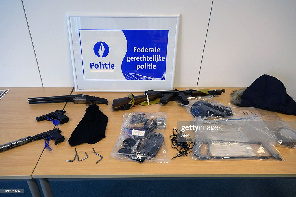 A picture taken on May 17, 2013 shows weapons at a presentation of evidence of multiple cases of ram-raid crimes, on May 17, 2013 at the buildings of the Federal Police in Antwerp. The raids happened in the Wijnegem Shopping Center on April 30, a jeweler in Zundert on May 16, and in Netherlands among others. Belgium Out