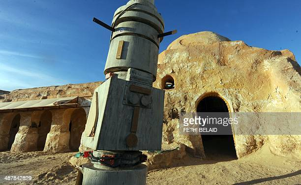 A picture taken on May 2 2014 shows amidst desert sand a film set where numerous Star Wars scenes were filmed in Ong Jmel in southern Tunisia The...
