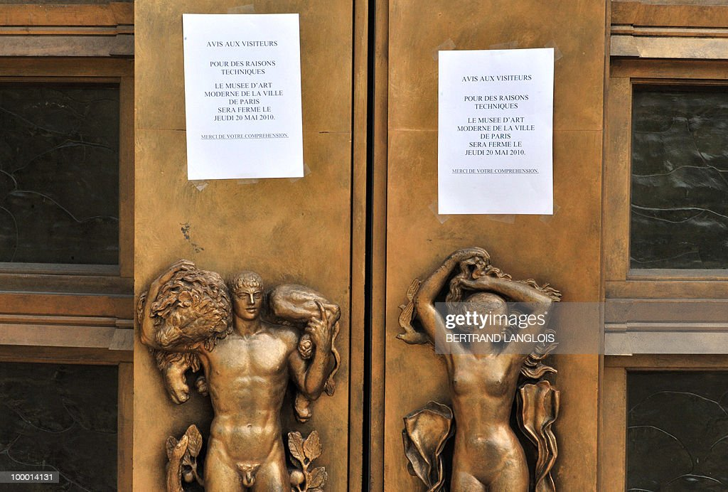 A picture taken on May 20, 2010 shows information notes on the door of the Paris' Musee d'Art Moderne (Paris modern art museum), closed after five works including paintings by modern masters Henri Matisse and Pablo Picasso have been stolen. The canvases, worth a total of 500 million euros (635 million dollars), were discovered missing from the city-run Musee d'Art Moderne when it opened its doors.