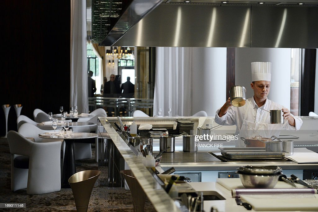 A picture taken on May 22, 2013 shows an employee in the kitchen of restaurant 'La Scene' at the luxury hotel 'Prince de Galles' (Prince of Wales) in Paris. The Prince de Galles, on the Avenue George V in Paris reopened on May 16, 2013 under the 'Luxury Collection' brand after two years of renovation. The luxury hotel, with 159 rooms, a restaurant and bar, was built in 1928 and was closed since February 2011. The hotel received a fifth star on its reopening.