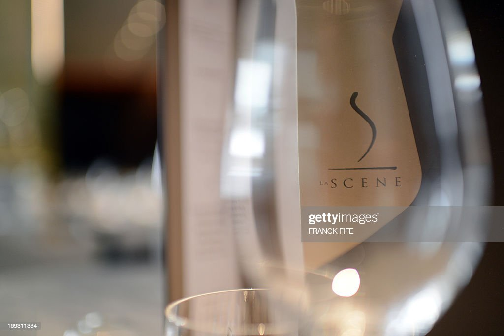 A picture taken on May 22, 2013 shows the logo of the restaurant 'La Scene' as seen through a wine glass, at the luxury hotel 'Prince de Galles' (Prince of Wales) in Paris. The Prince de Galles, on the Avenue George V in Paris reopened on May 16, 2013 under the 'Luxury Collection' brand after two years of renovation. The luxury hotel, with 159 rooms, a restaurant and bar, was built in 1928 and was closed since February 2011. The hotel received a fifth star on its reopening.