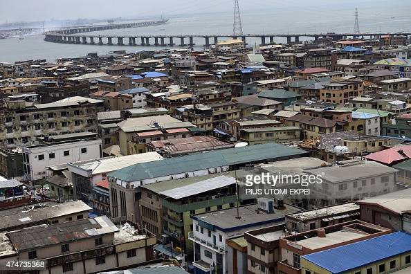 A picture taken on May 22 2015 shows buildings over looking the third Mainland bridge the longest bridge in West Africa in Nigeria's commercial...