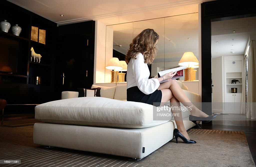 A picture taken on May 22, 2013, shows a woman in a suite at the luxury hotel 'Prince de Galles' (Prince of Wales), in Paris. The Prince de Galles, on the Avenue George V in Paris reopened on May 16, 2013 under the 'Luxury Collection' brand after two years of renovation. The luxury hotel, with 159 rooms, a restaurant and bar, was built in 1928 and was closed since February 2011. The hotel received a fifth star on its reopening.