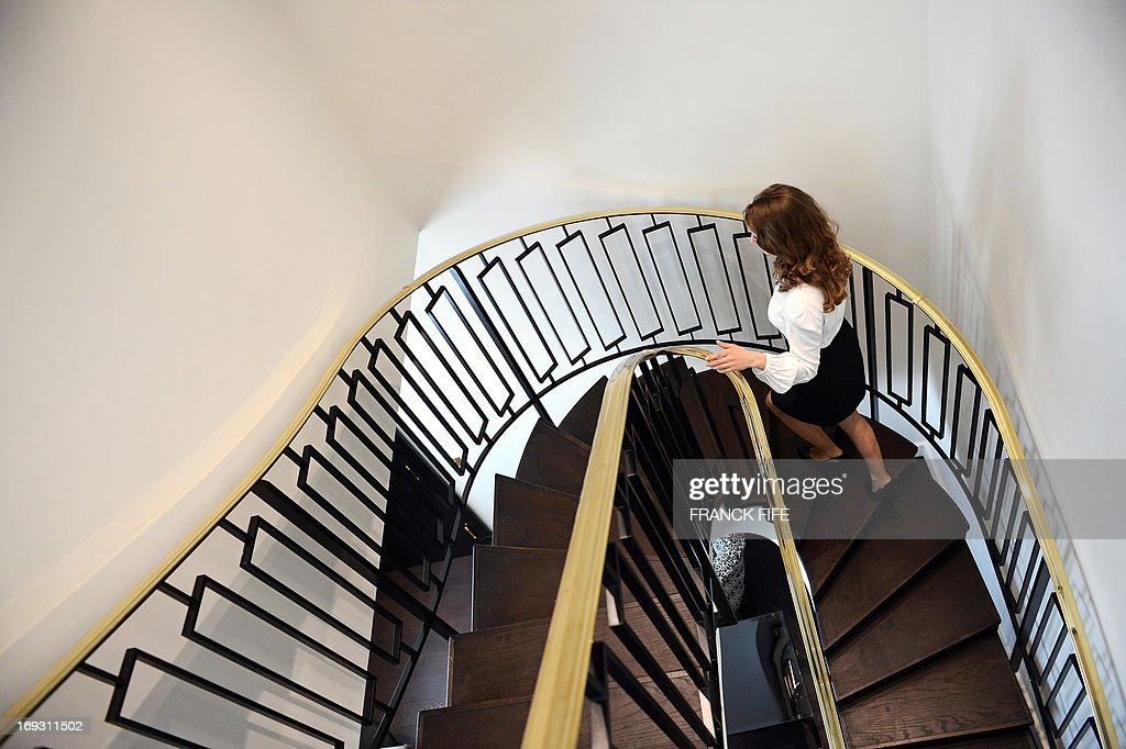 A picture taken on May 22, 2013, shows a woman walkng up the stairs in a suite at the luxury hotel 'Prince de Galles' (Prince of Wales), in Paris. The Prince de Galles, on the Avenue George V in Paris reopened on May 16, 2013 under the 'Luxury Collection' brand after two years of renovation. The luxury hotel, with 159 rooms, a restaurant and bar, was built in 1928 and was closed since February 2011. The hotel received a fifth star on its reopening.