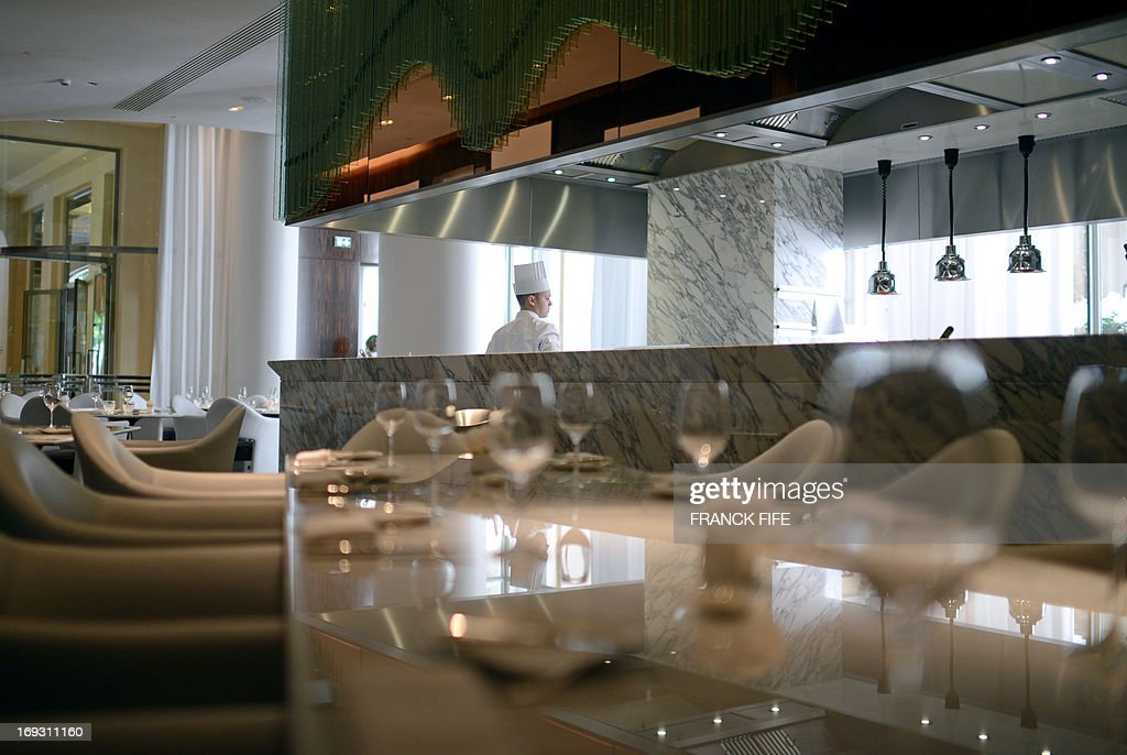 A picture taken on May 22, 2013, shows an employee in the kitchen of the restaurant 'La Scene' of the luxury hotel 'Prince de Galles' (Prince of Wales) in Paris. The Prince de Galles, on the Avenue George V in Paris reopened on May 16, 2013 under the 'Luxury Collection' brand after two years of renovation. The luxury hotel, with 159 rooms, a restaurant and bar, was built in 1928 and was closed since February 2011. The hotel received a fifth star on its reopening.