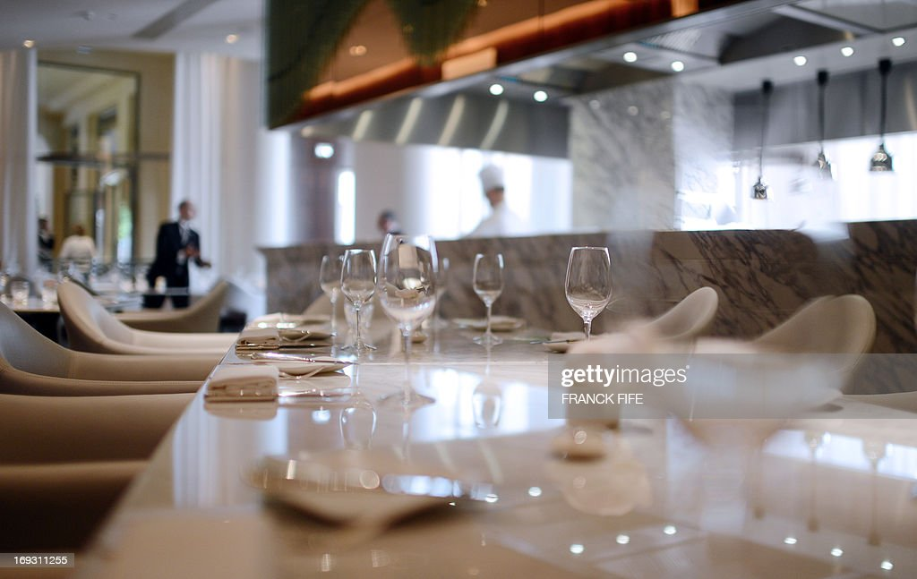 A picture taken on May 22, 2013, shows the restaurant 'La Scene' of the luxury hotel 'Prince de Galles' (Prince of Wales) in Paris. The Prince de Galles, on the Avenue George V in Paris reopened on May 16, 2013 under the 'Luxury Collection' brand after two years of renovation. The luxury hotel, with 159 rooms, a restaurant and bar, was built in 1928 and was closed since February 2011. The hotel received a fifth star on its reopening. AFP PHOTO / FRANCK FIFE