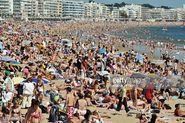 A picture taken on May 23 2010 in the French western city of La Baule shows people on the beach French National Institute for Statistics and Economic...