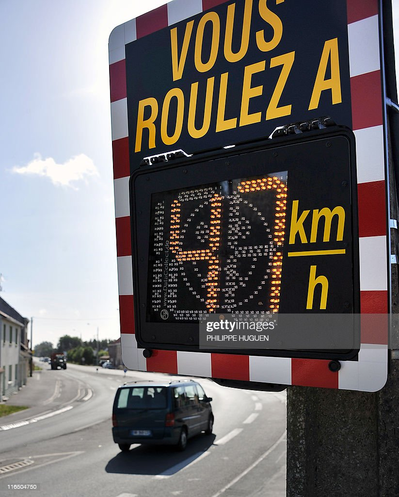 A picture taken on May 23, 2011 in Bailleul, northern France, shows an information radar showing the speed of a vehicle. France's Interior Minister Claude Gueant announced on May 22, 2001, the installation next week of around one thousand information radars in France, showing the speed without applying any sanctions against the drivers.