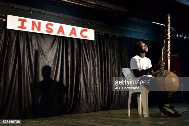 A picture taken on May 23 shows a student playing kora at the National Higher Institute of Arts and Cultural Action in Abidjan The Insaac the famous...