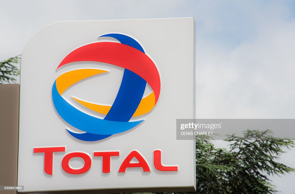 A picture taken on May 24, 2016 shows the logo of French oil giant Total in Lille, northern France. Blockades of five refineries run by Total in France will cause the French oil giant to 'seriously review' its domestic investments, the group's CEO said on May 24. The refinery blockades are part of demonstrations against the government's labour market reforms that opponents say are weighed in favour of business. / AFP / DENIS