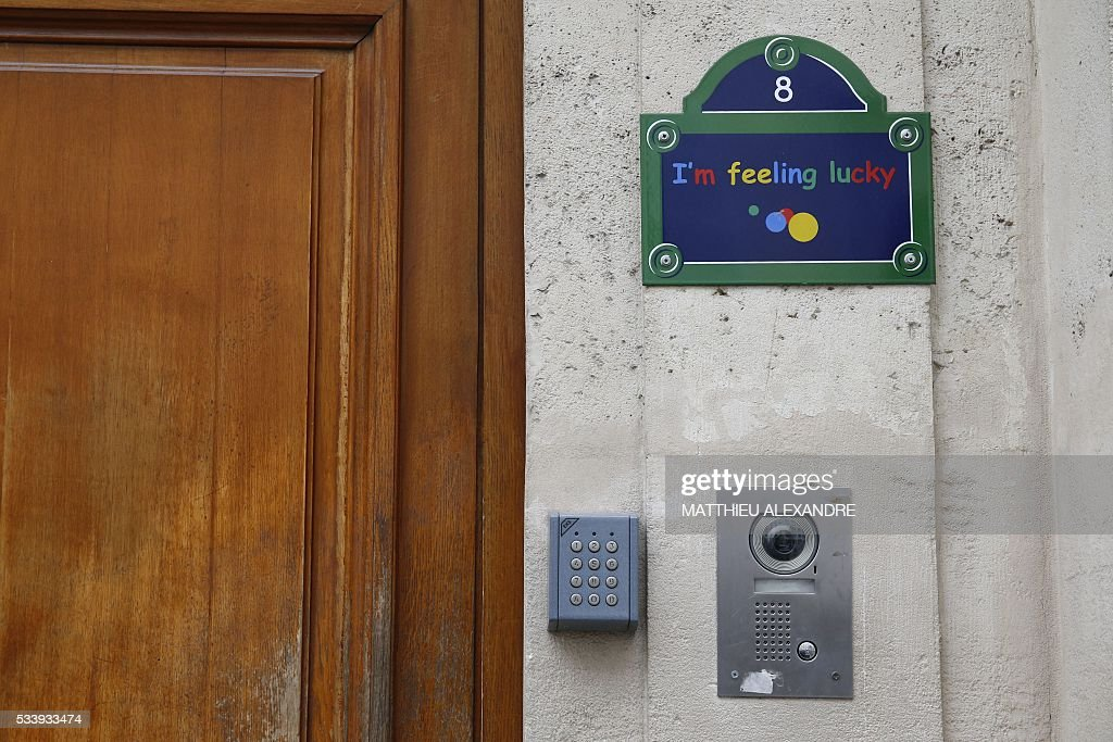 Picture taken on May 24, 2016, shows the entrance of the building where the Paris offices of US Internet giant Google are located following a police search as part of a tax fraud investigation. French authorities believe Google owes 1,6 billion euros (USD 1,7 billion) in back taxes, a source close to the matter said in February. Google is one of several multinational corporations that have come under fire in Europe for paying extremely low taxes by shifting revenue across borders in an often complex web of financial arrangements.