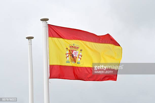 A picture taken on May 25 2016 in SaintMartindeRe shows the Spanish national flag fluttering in the air on the football field on which Spain's...