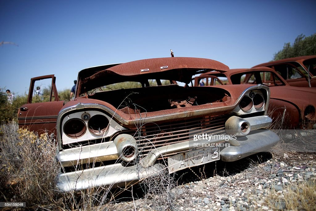 A picture taken on May 25, 2016 shows a close up of an abandoned late 1950s Dodge Cornet car parked at the Sovereign Base Area of Akrotiri, a British overseas territory located ten kilometres west of the Cypriot port city of Limassol. Abandoned in the streets of the base after the war, hundreds of vehicles that belonged to Turkish Cypriots, mostly dating from the 1960s, had been gathered in a vast wasteland in 1975 await their owners on the British base of Akrotiri, 42 years after being left behind in the divided island. The British authorities have recently undertaken an inventory of 400 vehicles in the hope of regaining their former owners, listing images and details of them on an internet site. / AFP / BEHROUZ