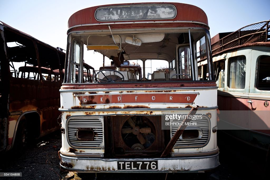A picture taken on May 25, 2016 shows a late 1960s Bedford bus parked at the Sovereign Base Area of Akrotiri, a British overseas territory located ten kilometres west of the Cypriot port city of Limassol. Abandoned in the streets of the base after the war, hundreds of vehicles that belonged to Turkish Cypriots, mostly dating from the 1960s, had been gathered in a vast wasteland in 1975 await their owners on the British base of Akrotiri, 42 years after being left behind in the divided island. The British authorities have recently undertaken an inventory of 400 vehicles in the hope of regaining their former owners, listing images and details of them on an internet site. / AFP / BEHROUZ